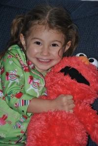Hugging on Elmo, under the Christmas Tree Lights  :)