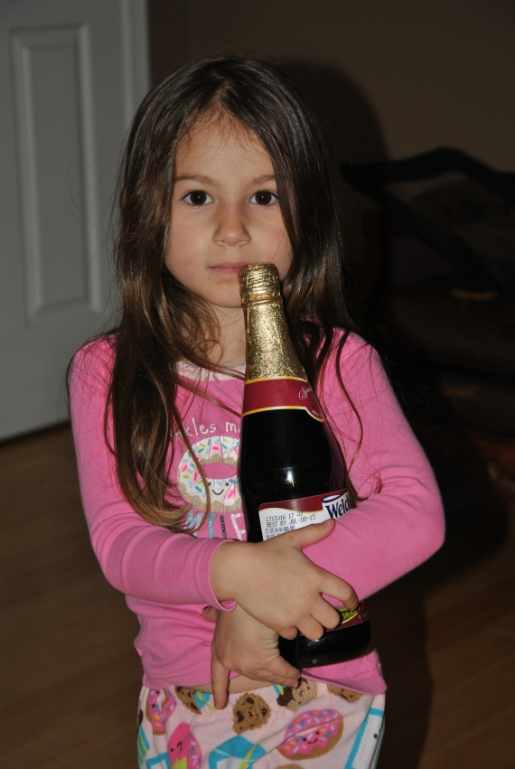 Carefully carrying the Sparkling Grape Juice!