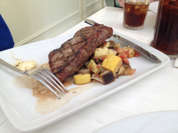 New York Strip Steak with a Red Wine Butter, Tony's Potatoes, and Seasonal Vegetables