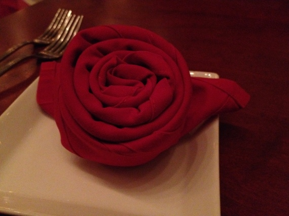 Napkin Rose - Auntie M spent the time we were waiting at our table teaching B10 and CW how to make them.