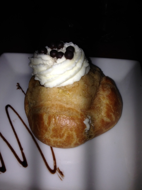 Chocolate Cream Puff Filled with Chocolate Mousse topped with Whipped Cream