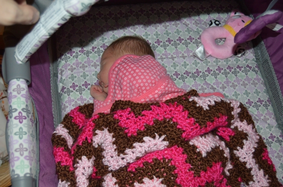 Napping in her crib - with her blanket by Queen.