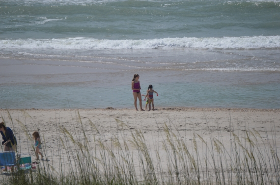 The view from our balcony - looking at the two older girls in the surf.